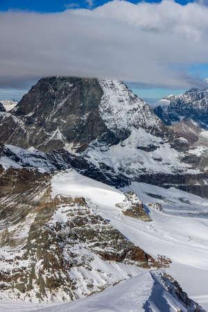 valais: clouds covering Swiss Alps near Mount Matterhorn, Canton of Valais, Switzerland Stock Photo