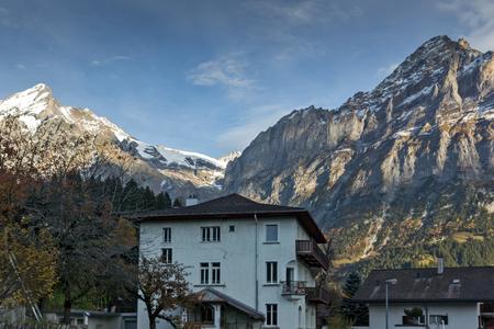 eiger: Village of Grindelwald and mount Wetterhornin Alps near town of Interlaken, Switzerland