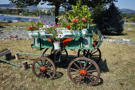 Wagon covered with flowers in the yard in Monastery St. John the Baptist, Kardzhali,  Bulgaria