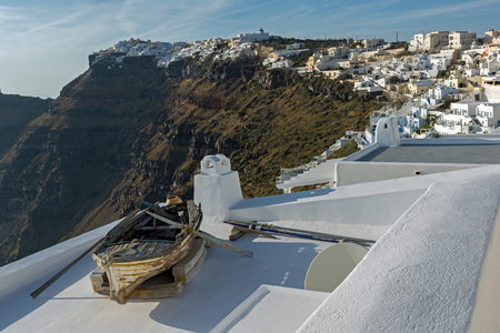 firostefani: Old boat and Panoramic view to towns of Imerovigli and Firostefani, Thira, Cyclades, Greece