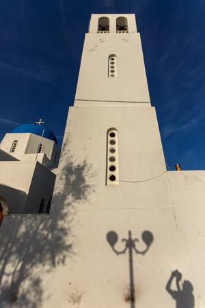 firostefani: White bell tower in town of Firostefani, Santorini island, Thira, Cyclades, Greece Stock Photo