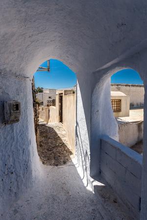 thira: Street in the castle of Pyrgos Kallistis, Santorini island, Thira, Cyclades, Greece Editorial