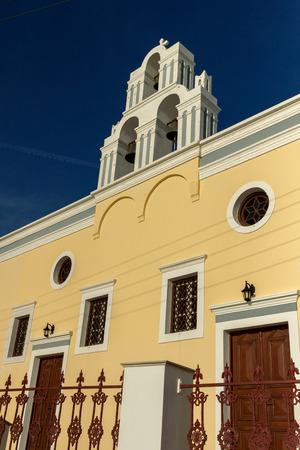thira: Sunset over yellow church, Fira, Santorini island, Thira, Cyclades, Greece
