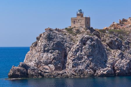ios: Amazing Seascape of Lighthouse of port of Ios island, Cyclades, Greece Stock Photo