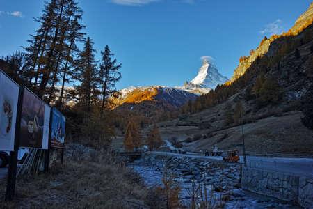 valais: First Rays of Sun over Matterhorn peak, view from Zermatt, Canton of Valais, Switzerland