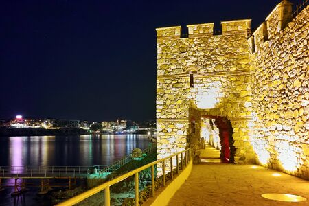 fortifications: Night photo of reconstructed gate part of Sozopol ancient fortifications, Bulgaria Stock Photo