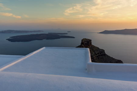 thira: Amazing sunset view from town of Imerovigli to volcano, Santorini island, Thira, Cyclades, Greece Stock Photo