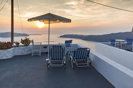 thira: Amazing Sunset landscape in town of imerovigli, Santorini island, Thira, Cyclades, Greece Stock Photo