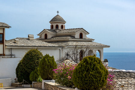 michael the archangel: Church andspring flowers in Archangel Michael Monastery in Thassos island, East Macedonia and Thrace, Greece Stock Photo