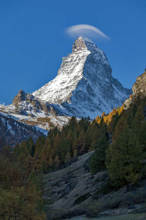 valais: Small cloud over Matterhorn peak, view from Zermatt, Canton of Valais, Switzerland Stock Photo