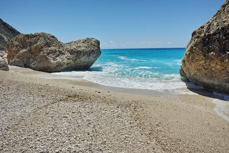 blue waters: Rocks in the blue waters of Megali Petra Beach, Lefkada, Ionian Islands, Greece