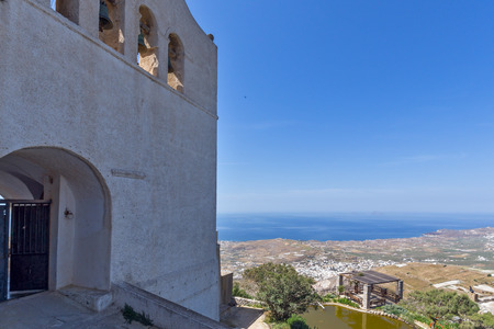 prophet: Entrance of Monastery Prophet Elias and panorama to Santorini island, Thira, Cyclades, Greece Stock Photo