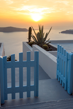 thira: Entrance of white house and sunset in town of Imerovigli, Santorini island, Thira, Cyclades, Greece