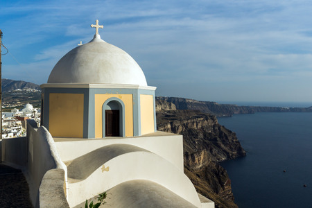 firostefani: Orthodox church in town of Firostefani and panorama Santorini island, Thira, Cyclades, Greece Stock Photo