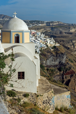 firostefani: Orthodox church in town of Firostefani and panoramic view of Santorini island, Thira, Cyclades, Greece