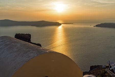 thira: White roof and Amazing sunset in town of Imerovigli, Santorini island, Thira, Cyclades, Greece