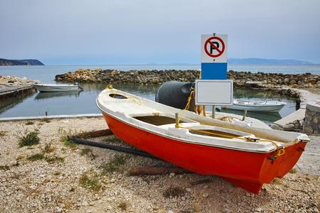 cefallonia: Boat at Small port on the coastline of Kefalonia, Ionian Islands, Greece Stock Photo