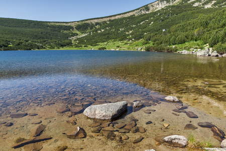 clear waters: Clear waters of Bezbog lake, Pirin Mountain, Bulgaria Stock Photo
