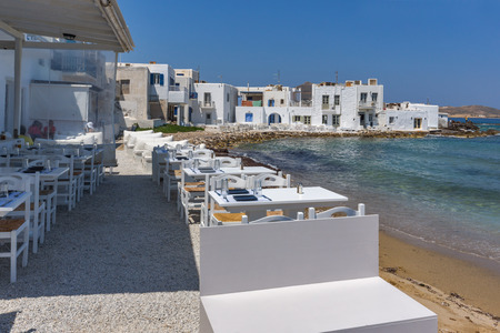 old town house: Old white house and Bay in Naoussa town, Paros island, Cyclades, Greece Stock Photo