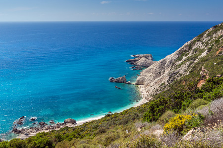 ionian: Rocks and blue waters near Petani Beach, Kefalonia, Ionian Islands, Greece Stock Photo