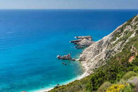 blue waters: Rocks and blue waters near Petani Beach, Kefalonia, Ionian Islands, Greece Stock Photo