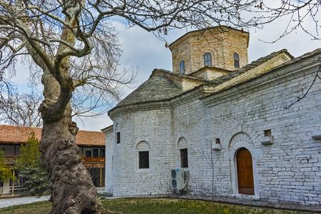 Church St. Petka and venerable tree in Gornovoden monastery St. Kirik and Julita, Asenovgrad,  Plovdiv Region,  Bulgaria Stock Photo