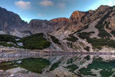 Sunrise view of Sinanitsa peak and lake, Pirin Mountain, Bulgaria