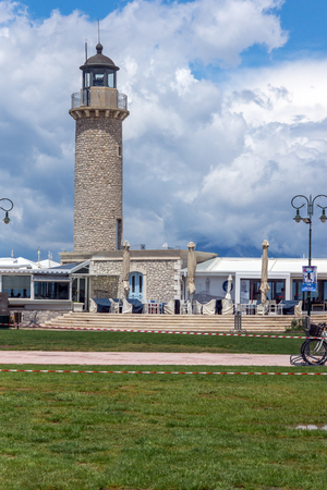 pharos: Cloudscape with Lighthouse in Patras, Peloponnese, Western Greece