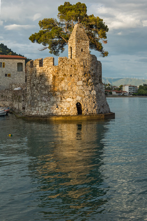 fortification: Amazing Sunset of Fortification at the port of Nafpaktos town, Western Greece Editorial