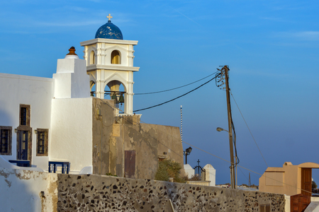 firostefani: bell tower of orthodox church in town of Firostefani, Santorini island, Thira, Cyclades, Greece Stock Photo