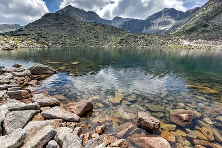 rocks water: rocky shore of  Musalenski lakes,  Rila mountain, Bulgaria Stock Photo