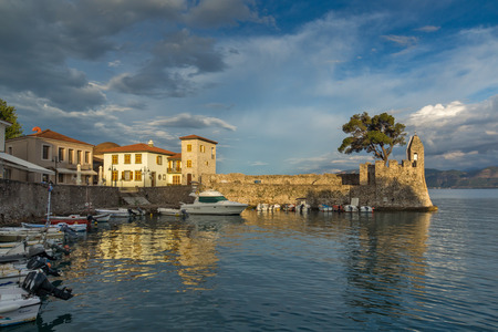 fortification: Amazing Sunset of Fortification at the port of Nafpaktos town, Western Greece Stock Photo