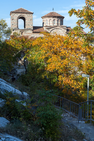 assen: Yellow trees and Church of the Holy Mother of God in Asens Fortress, Asenovgrad, Plovdiv Region, Bulgaria