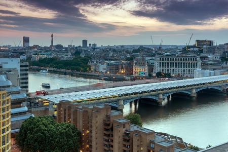 Sunset skyline of city of London and Blackfriars Bridge, England, Great Britain Stock Photo