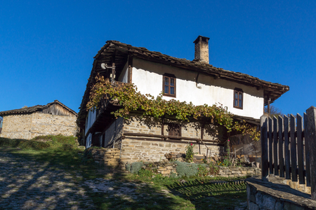 Old house with vine in village of Bozhentsi, Gabrovo region, Bulgaria
