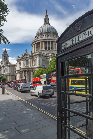 LONDON, ENGLAND - JUNE 15 2016:St. Paul Cathedral and Phone booth in London, Great Britain