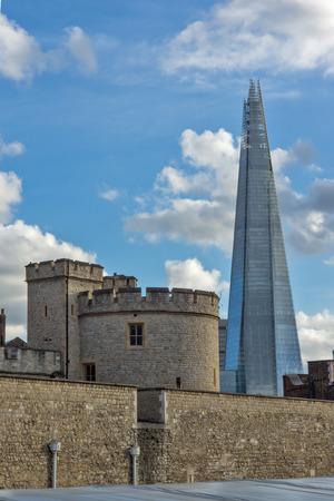 shard: LONDON, ENGLAND - JUNE 15 2016: Panorama with Tower of London and The Shard, London, England, Great Britain