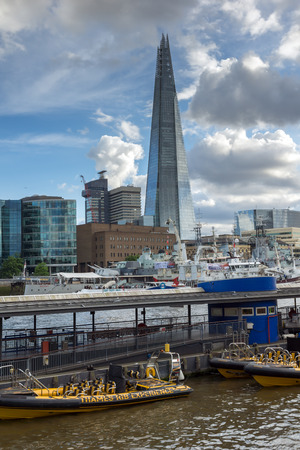 LONDON, ENGLAND - JUNE 15 2016: View of The Shard skyscraper from Thames river, England, Great Britain