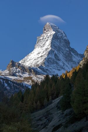 Matterhorn covered with small cloud, Canton of Valais, Alps, Switzerland