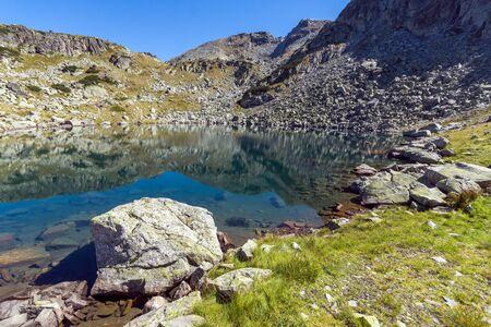 Amazing panorama of Lake and reflection of Preokorets (Popova Kapa) peak, Rila Mountain, Bulgaria