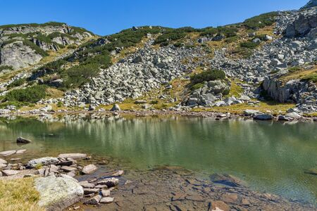 Landscape with Stones in the water in small Lake, Rila Mountain, Bulgaria