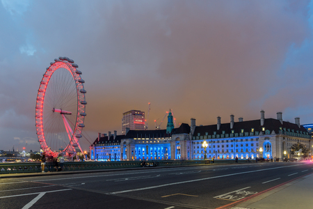 riverside county: LONDON, ENGLAND - JUNE 16 2016: Night photo of The London Eye and County Hall from Westminster bridge, London, England, Great Britain