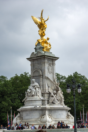 angels fountain: LONDON, ENGLAND - JUNE 17 2016: Queen Victoria Memorial in front of Buckingham Palace, London, England, United Kingdom