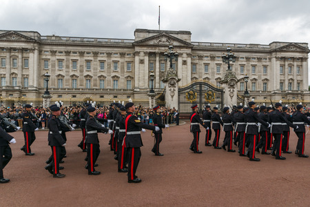 angels fountain: LONDON, ENGLAND - JUNE 17 2016: British Royal guards perform the Changing of the Guard in Buckingham Palace, London, England, Great Britain Editorial