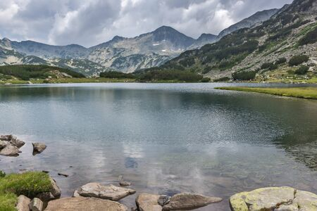 stream: Landscape of Banderishki Chukar Peak in Muratovo lake, Pirin Mountain, Bulgaria Stock Photo
