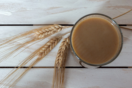 balkan peninsula: Traditional Drink from Balkan Peninsula Boza (fermented cereal beverage) and wheat over white wooden background