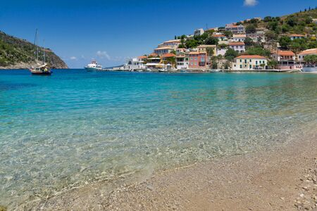 cefalonia: Clean waters of beach of Assos village and beautiful sea bay, Kefalonia, Ionian islands, Greece Stock Photo