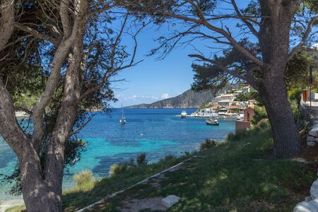 Beach of Assos village and beautiful sea bay, Kefalonia, Ionian islands, Greece