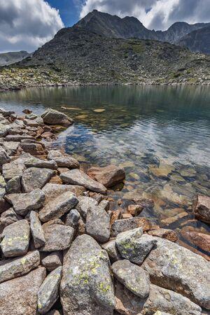 Reflection of Irechek peak in Musalenski lakes,  Rila mountain, Bulgaria