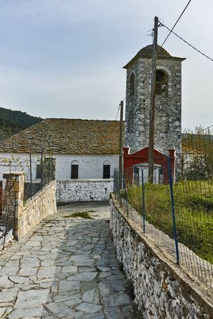 Bell Tower of Orthodox church with stone roof in village of Theologos,Thassos island, East Macedonia and Thrace, Greece Stock Photo